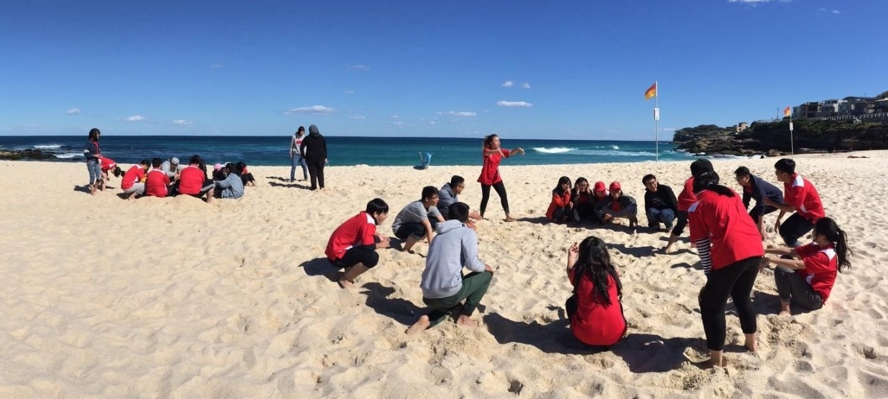 Images of happy students from different cultural backgrounds enjoying a beach excursion.